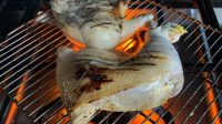 flame broiled chicken on stove